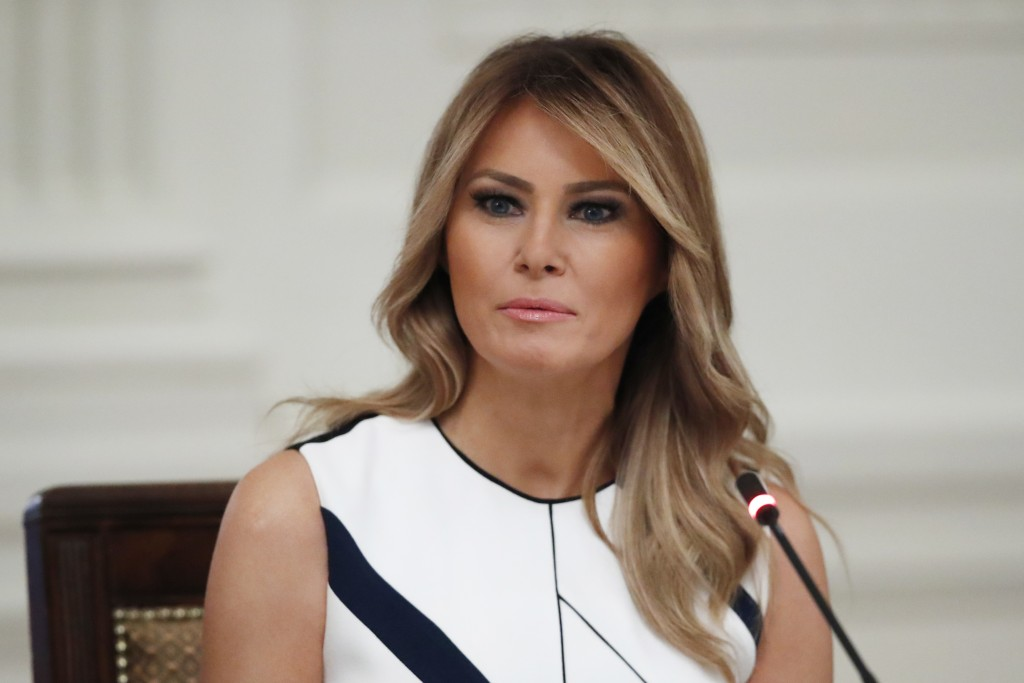 """FILE - In this July 7, 2020 file photo, first lady Melania Trump listens during a """"National Dialogue on Safely Reopening America's Schools,"""" event in ..."""