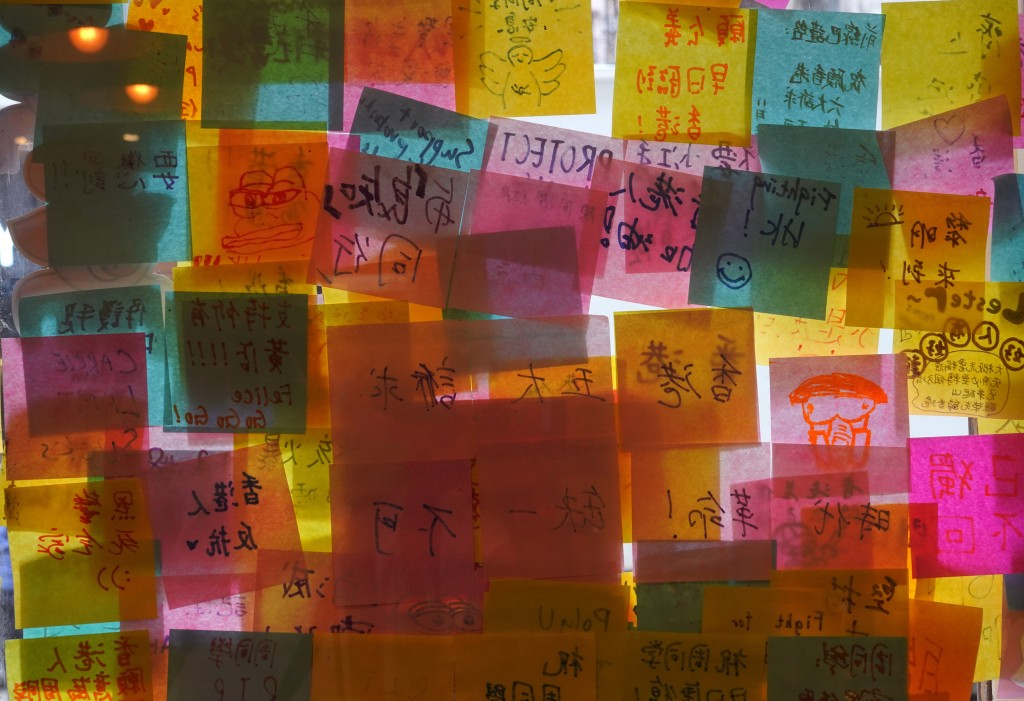 """A window is decorated with post-it notes at Hong Kong Cafe, known as a """"yellow shop"""" because its owners expressed sympathy for protesters, in Hong Kon..."""