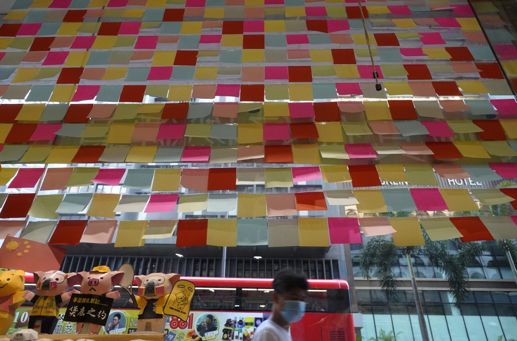 "A Hong Kong Cafe, known as a ""yellow shop"" because its owners expressed sympathy for protesters has windows decorated with blank post-it notes in Hong..."