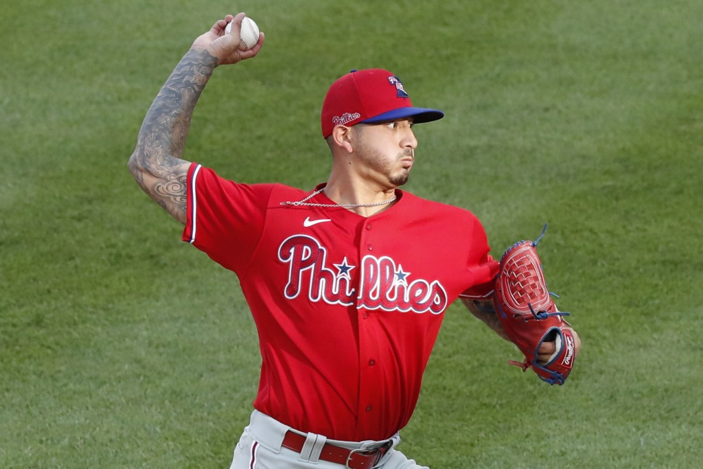 Philadelphia Phillies starting pitcher Vince Velasquez winds up during the first inning of an exhibition baseball game against the New York Yankees, M...