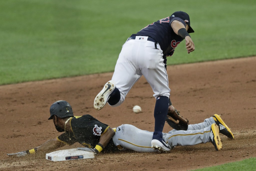 Pittsburgh Pirates' Jarrod Dyson slides safely into second base for a steal as Cleveland Indians' Cesar Hernandez can't get to the ball in the fifth i...