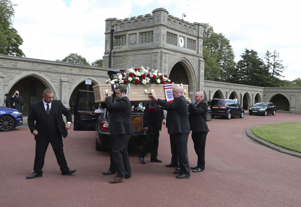 Pall bearers carry the coffin of Jack Charlton at West Road Crematorium, in Newcastle, England, for his funeral, Tuesday July 21, 2020.  Charlton, who...