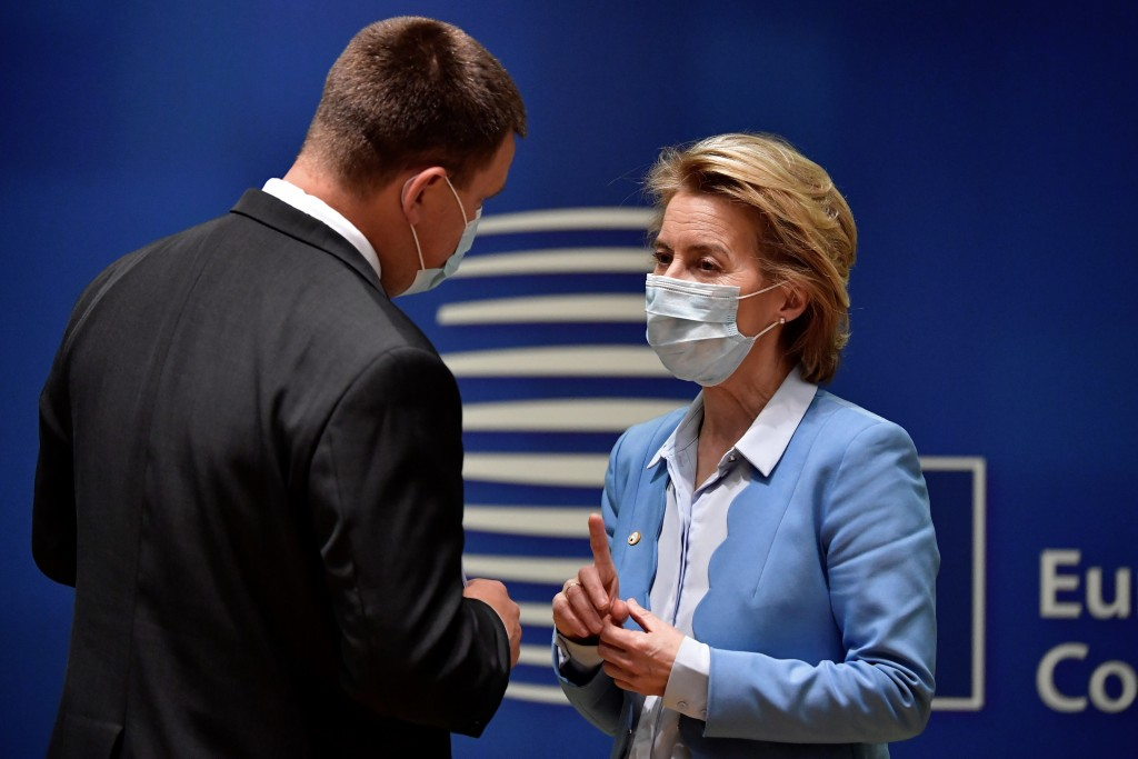 European Commission President Ursula von der Leyen, right, speaks with Estonia's Prime Minister Juri Ratas during a round table meeting at an EU summi...