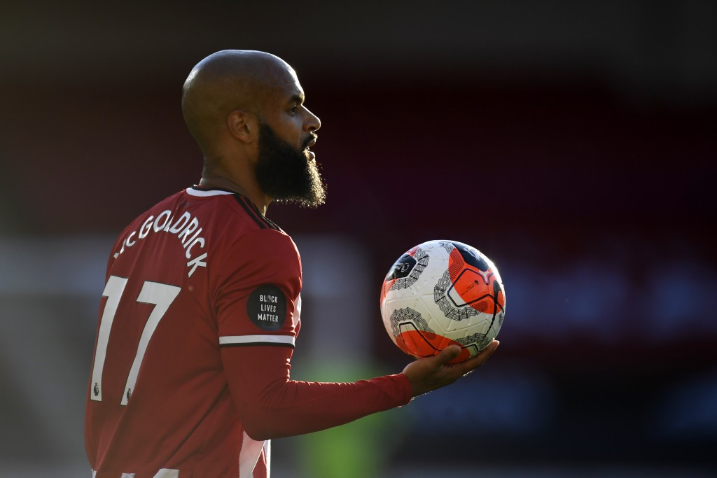 Sheffield United's David McGoldrick waits to throw in the ball during the English Premier League soccer match between Sheffield United and Everton at ...