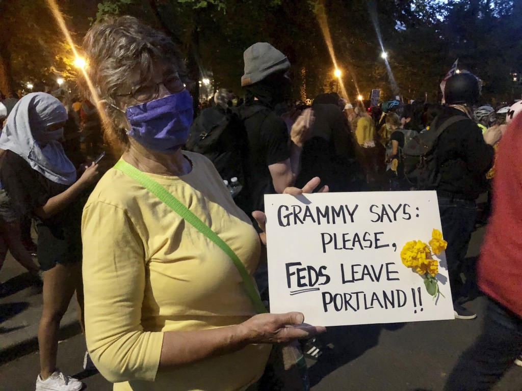 Mardy Widman, a 79-year-old grandmother of five, protests the presence of federal agents outside the Mark O. Hatfield Federal Courthouse in Portland, ...