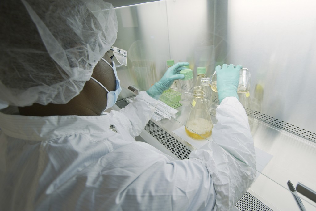 In this May 2020 photo provided by Eli Lilly, a researcher tests possible COVID-19 antibodies in a laboratory in Indianapolis. Antibodies are proteins...