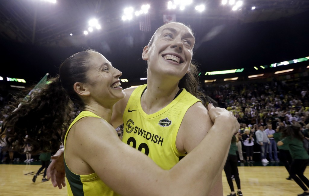 FILE - This Sept. 4, 2018, file photo shows Seattle Storm's Sue Bird, left, and Breanna Stewart embracing after the Storm defeated the Phoenix Mercury...
