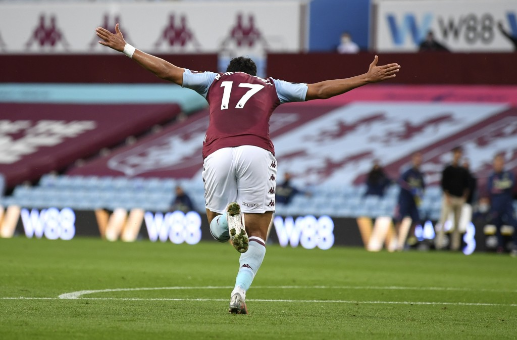Aston Villa's Trezeguet celebrates after scoring his team's first goal during the English Premier League soccer match between Aston Villa and Arsenal ...