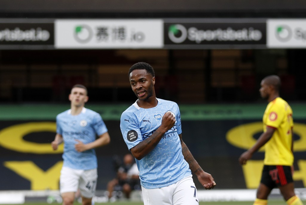 Manchester City's Raheem Sterling celebrates after scoring his side's opening goal during the English Premier League soccer match between Watford and ...