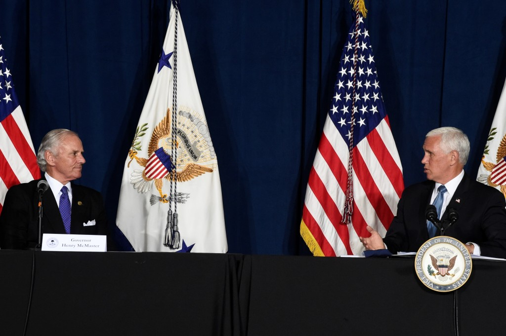 South Carolina Gov. Henry McMaster, left, looks on as Vice President Mike Pence, right, speaks at a round-table on re-opening schools amid the coronav...