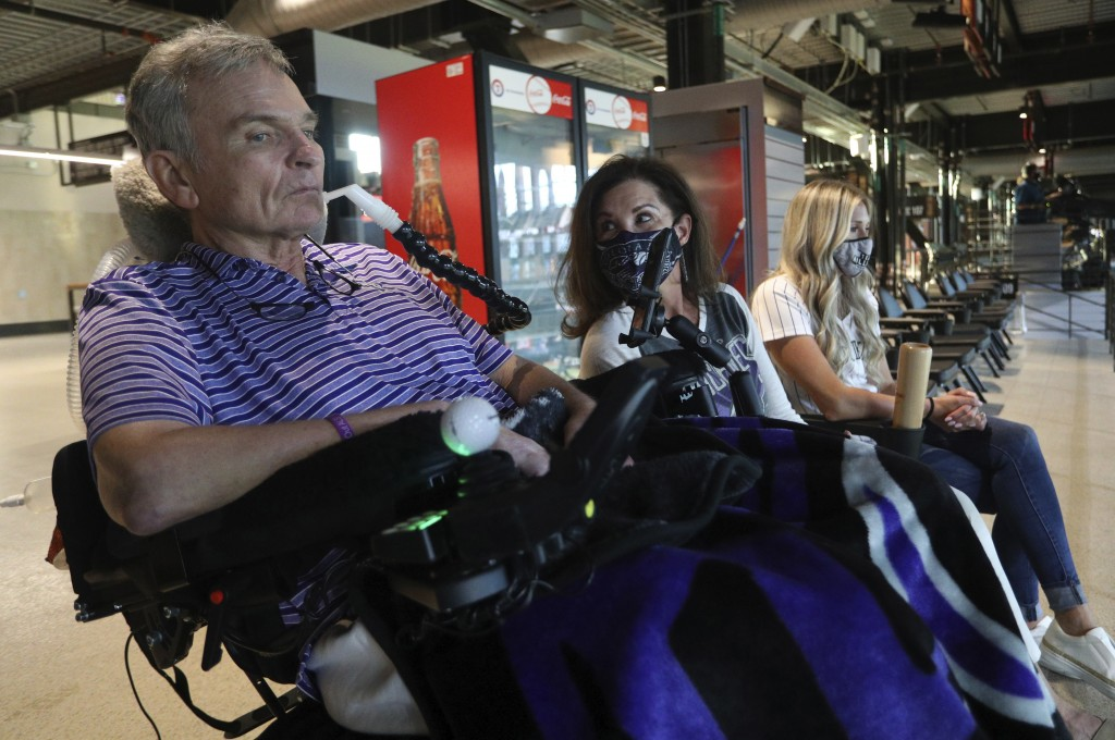 Jim Hilliard, Tamara Hilliard and Kat Minnerly watch the Colorado Rockies play against the Texas Rangers in an exhibition baseball game Tuesday, July ...