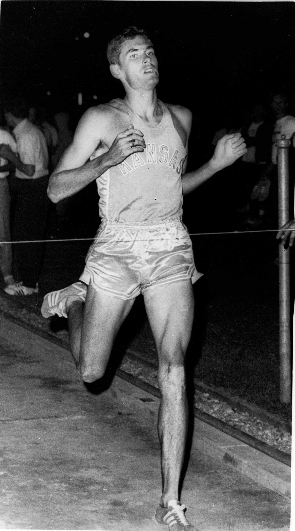 FILE - In this Aug, 10, 1968 file photo, Jim Ryun, back in competition after an attack of Mononucleosis sidelined him, sprints to victory in the Pre-O...