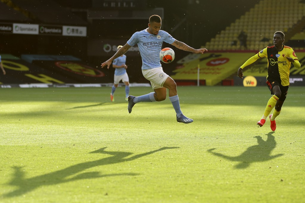 Manchester City's Gabriel Jesus, centre, controls the ball during the English Premier League soccer match between Watford and Manchester City at the V...