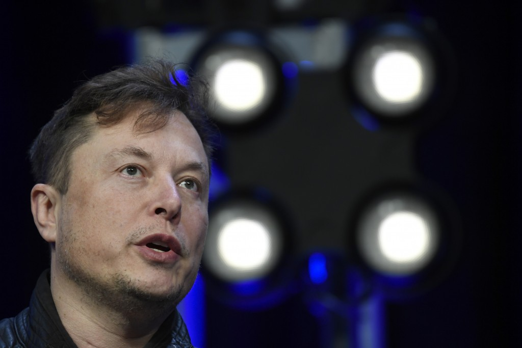 FILE - In this March 9, 2020, file photo, Tesla and SpaceX Chief Executive Officer Elon Musk speaks at the SATELLITE Conference and Exhibition in Wash...