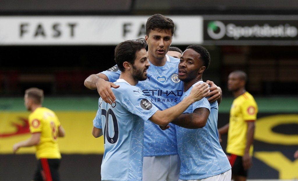 Manchester City's Raheem Sterling, right, celebrates with teammates after scoring his side's opening goal during the English Premier League soccer mat...