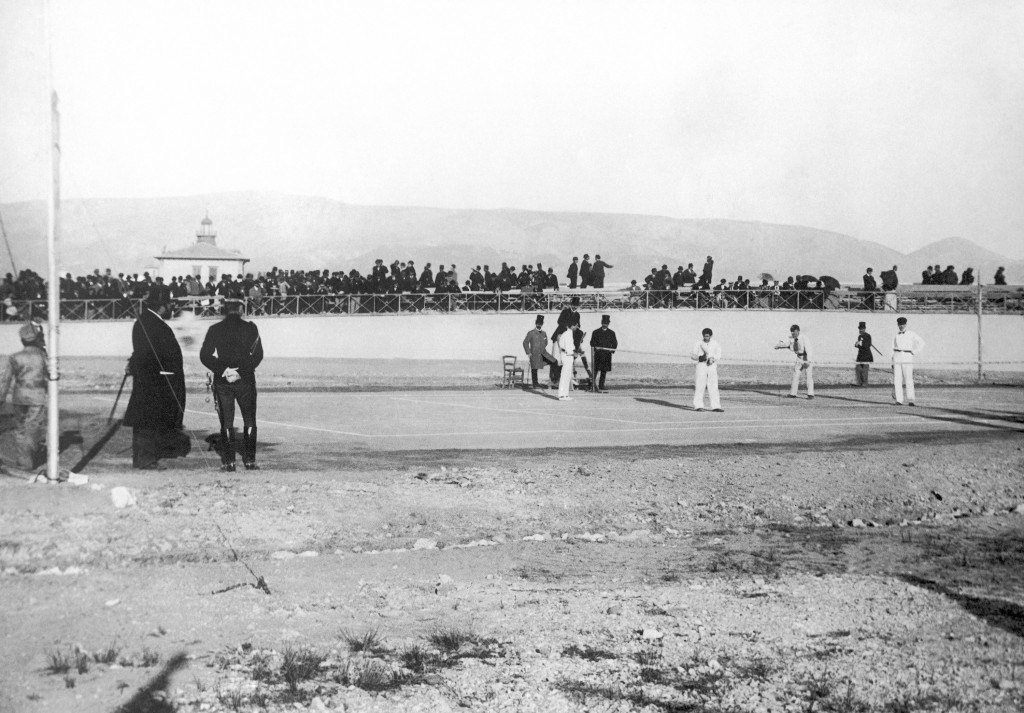 FILE - This April 11, 1896, file photo shows a doubles tennis match, Germany's Friedrich Traun and Ireland's John Pius Boland against Greek players Di...