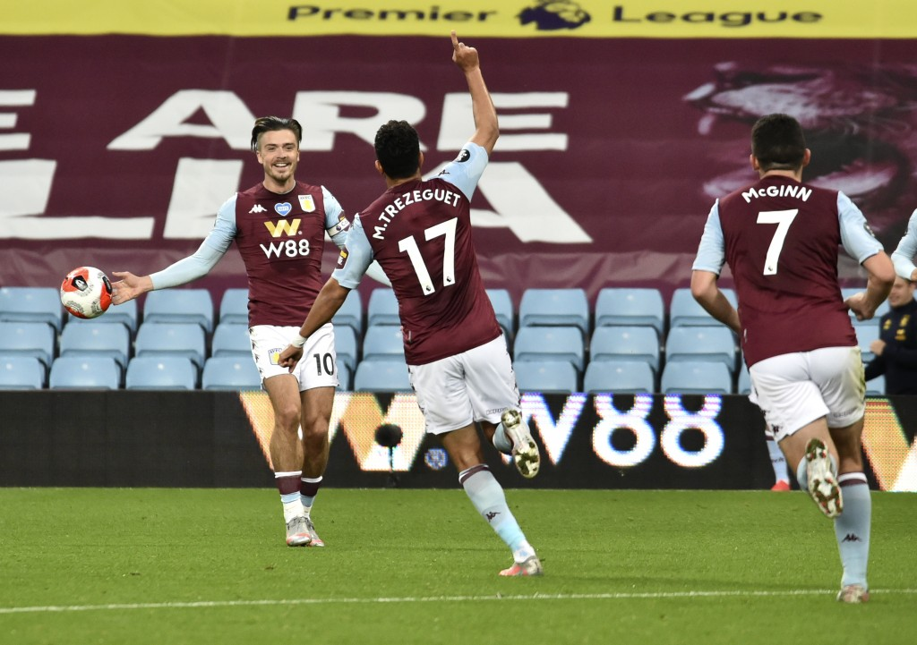 Aston Villa's Trezeguet, centre, celebrates with teammate Jack Grealish, left, after scoring his team's first goal during the English Premier League s...