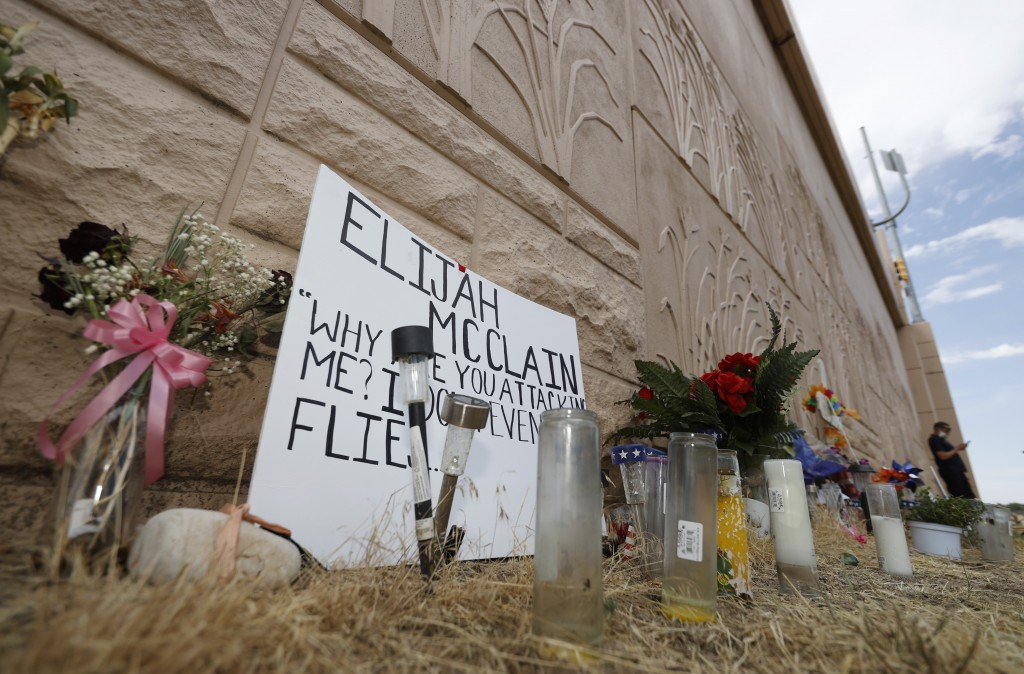FILE - In this July 3, 2020, file photo, a memorial site across the street from where Elijah McClain was stopped by Aurora, Colo., Police Department o...
