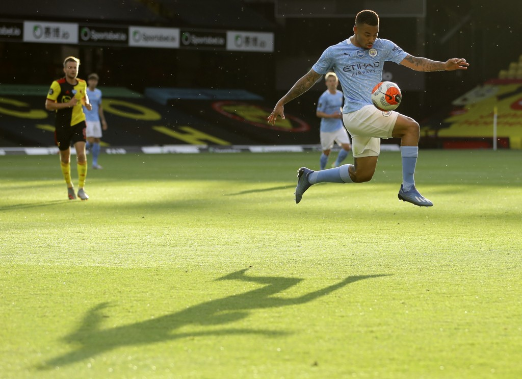 Manchester City's Gabriel Jesus controls the ball during the English Premier League soccer match between Watford and Manchester City at the Vicarage R...