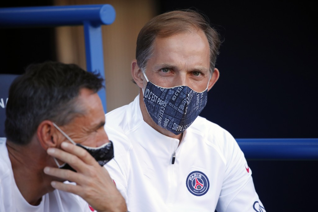 PSG's head coach Thomas Tuchel, right, wearing face mask look on during a friendly soccer match between Paris Saint Germain and Glasgow Celtic FC at P...