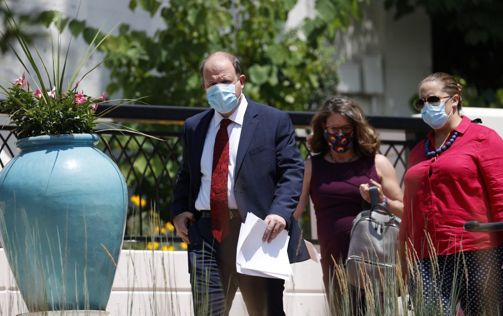 From left, Colorado Governor Jared Polis, Jill Hunsaker Ryan, executive director of the Colorado Department of Public Health and Environment, and Mari...