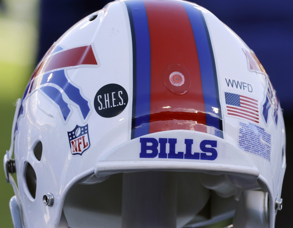 FILE - This Dec. 30, 2012, file photo shows a Buffalo Bills helmet displaying a WWFD (West Webster Fire Department) decal in memory of two fallen West...
