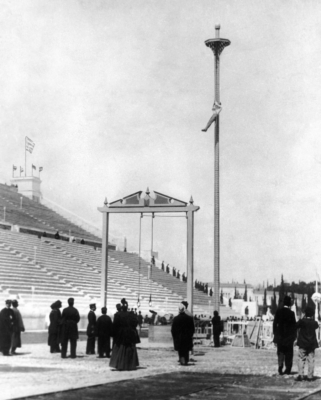 FILE - This April 10, 1896, file photo, shows Greek athlete Nikolaos Andriakopoulos on his way to winning the gold medal in the rope climbing event at...