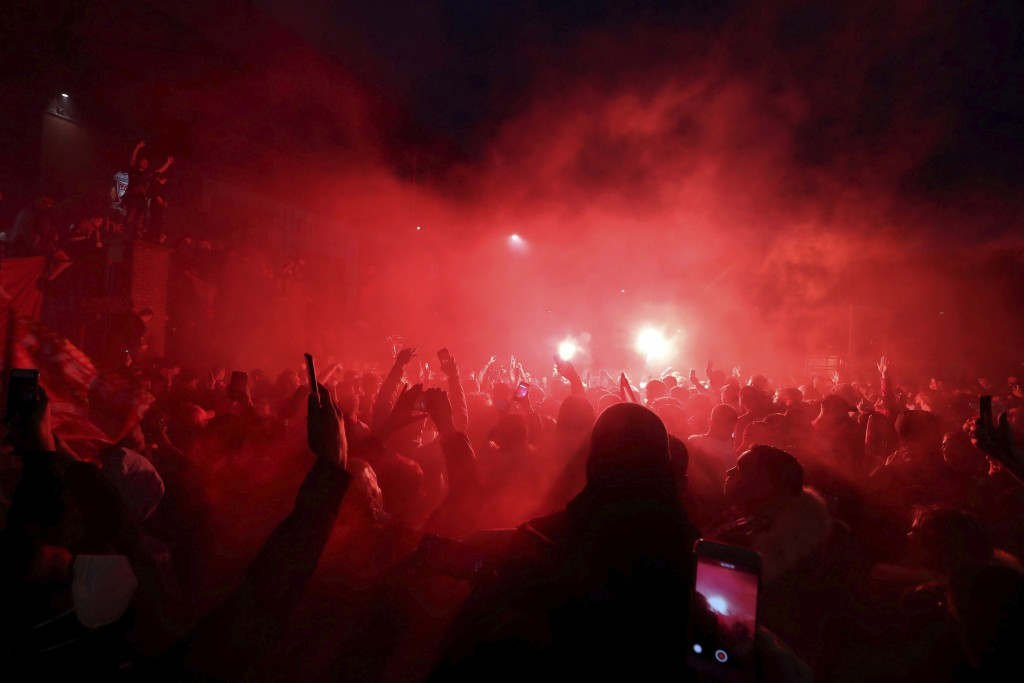 Liverpool fans celebrate outside Anfield stadium after the English Premier soccer match between Liverpool and Chelsea, Wednesday, July 22, 2020, in Li...