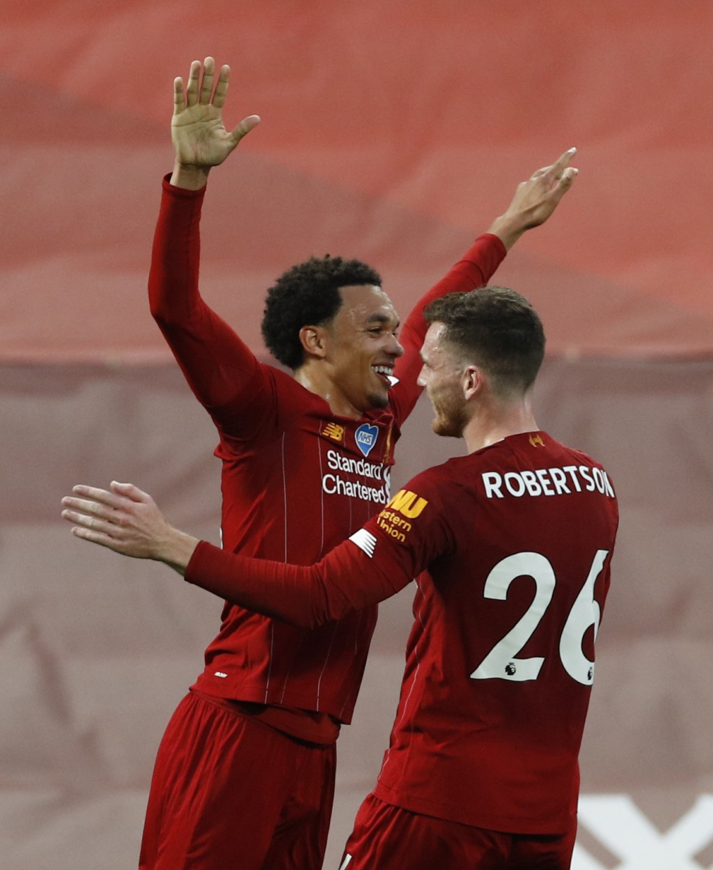 Liverpool's Trent Alexander-Arnold celebrates after scoring his sides 2nd goal of the game with teammate Liverpool's Andrew Robertson from a free kick...
