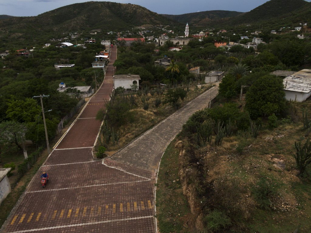 Small roads enter San Jeronimo Xayacatlan, Mexico, a town from which nearly a third of residents have emigrated to New York, Friday, June 26, 2020. Sa...