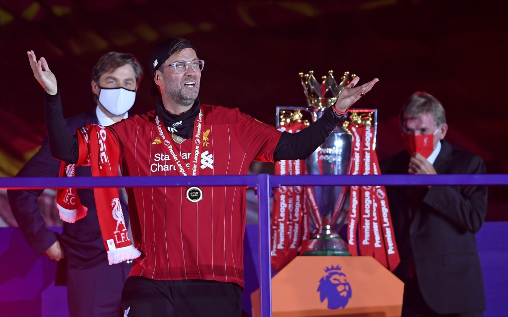 Liverpool's manager Jurgen Klopp celebrates after getting his winners medal following the English Premier League soccer match between Liverpool and Ch...