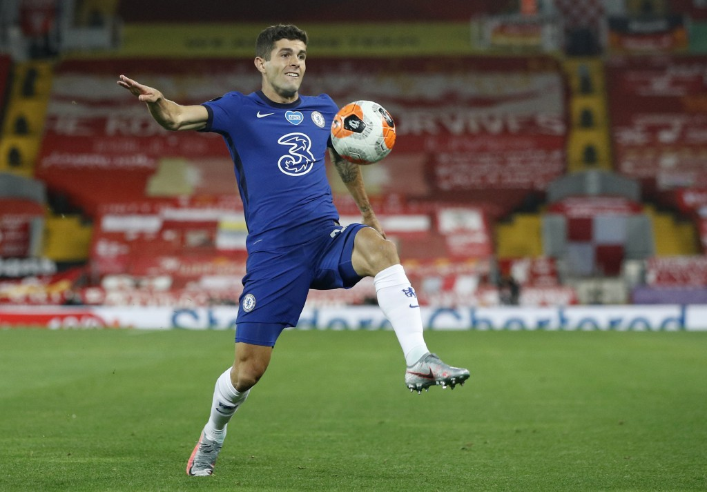 Chelsea's Christian Pulisic controls the ball during the English Premier League soccer match between Liverpool and Chelsea at Anfield Stadium in Liver...