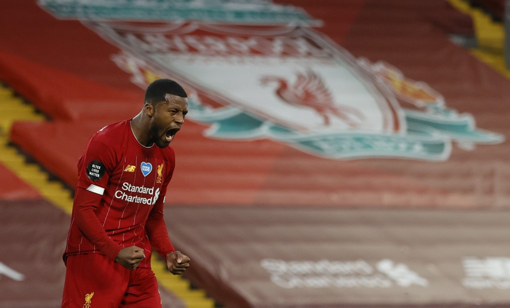 Liverpool's Georginio Wijnaldum, right turns and celebrates after scoring his sides 3rd goal during the English Premier League soccer match between Li...