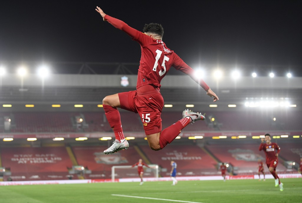 Liverpool's Alex Oxlade-Chamberlain celebrates scoring his side's fifth goal during the English Premier League soccer match between Liverpool and Chel...