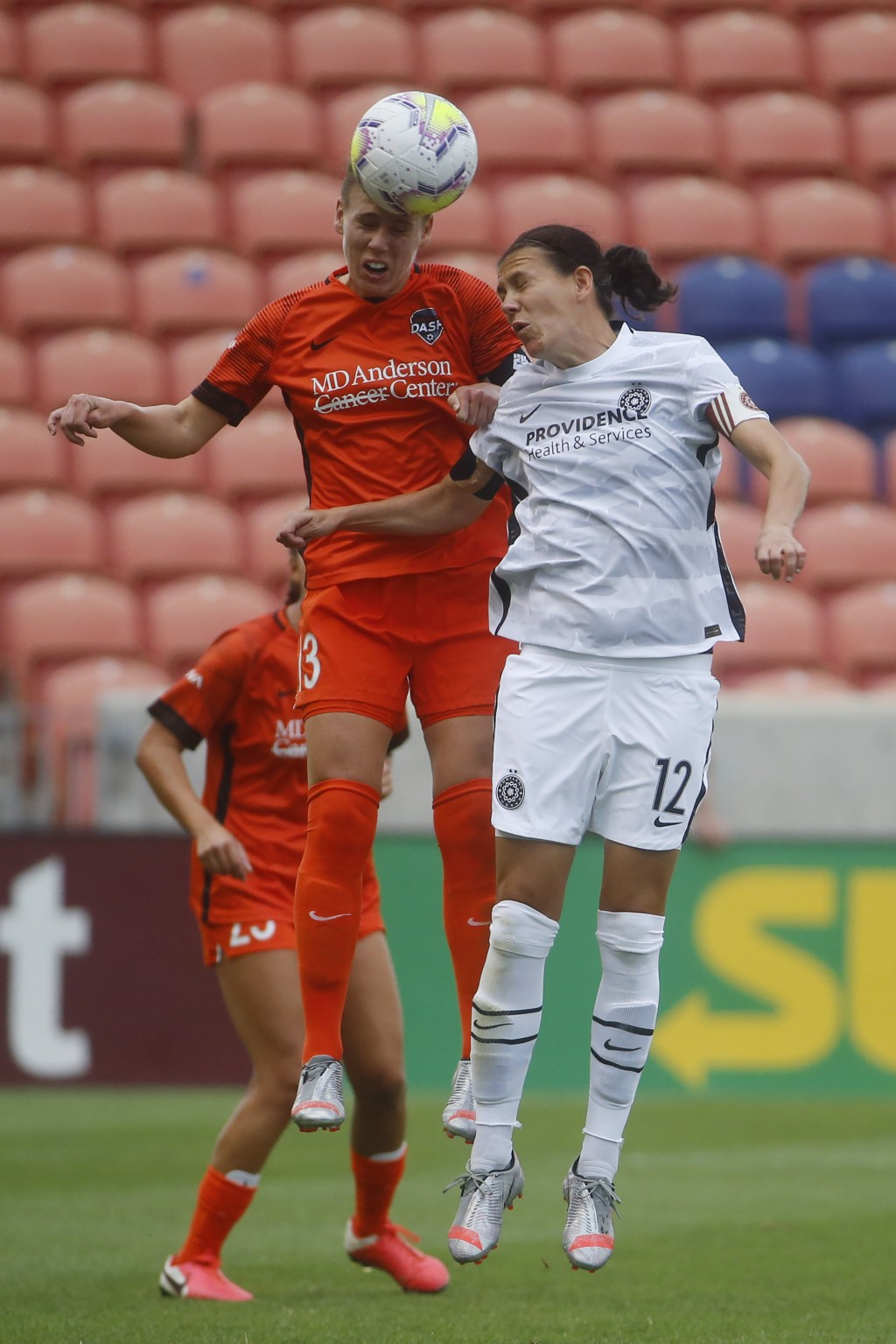 Houston Dash's Sophie Schmidt, left, battles for a head ball against Portland Thorns' forward Christine Sinclair (12) during the first half of an NWSL...