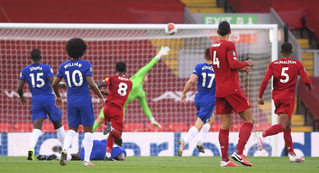 Liverpool's Naby Keita, center, scores the opening goal during the English Premier League soccer match between Liverpool and Chelsea at Anfield stadiu...