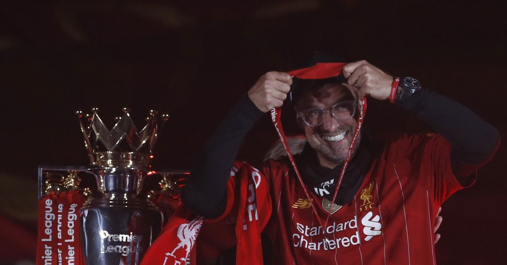 Liverpool's manager Jurgen Klopp puts on his winner medal prior to his team lifting the English Premier League trophy following the English Premier Le...