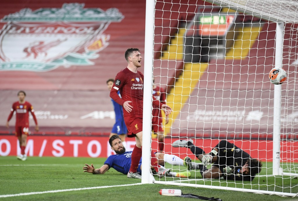 Chelsea's Olivier Giroud, bottom center, scores his side's opening goal during the English Premier League soccer match between Liverpool and Chelsea a...