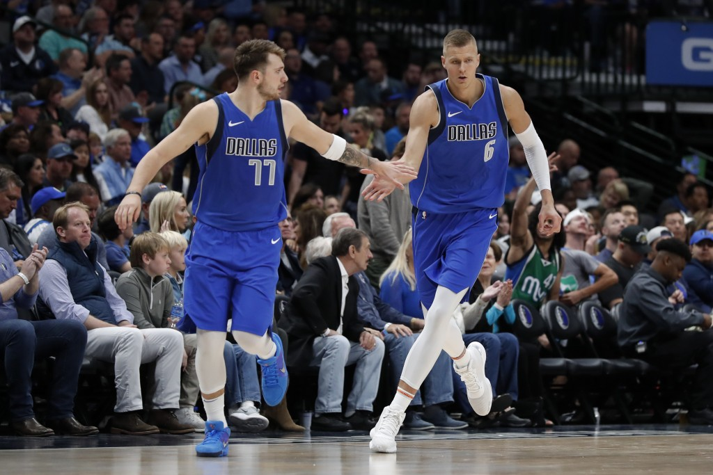 FILE - In this Oct. 27, 2019, file photo, Dallas Mavericks' Luka Doncic (77) and Kristaps Porzingis (6) celebrate a basket by Porzingis in the second ...