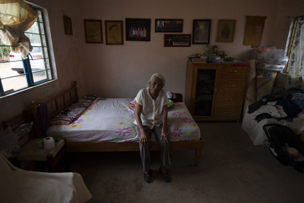 Catalina Vazquez poses for a portrait as she sits on her bed in San Jeronimo Xayacatlan, a town in Mexico from where nearly a third have emigrated to ...
