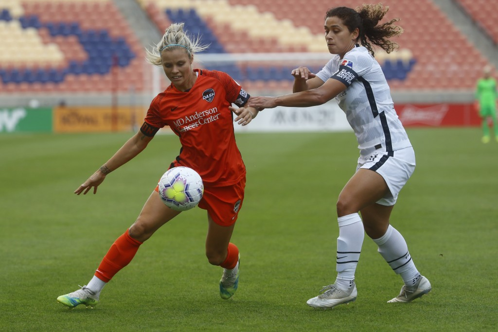 Houston Dash forward Rachel Daly, left, battles for the ball against Portland Thorns' Rocky Rodriguez (11) during the first half of an NWSL Challenge ...