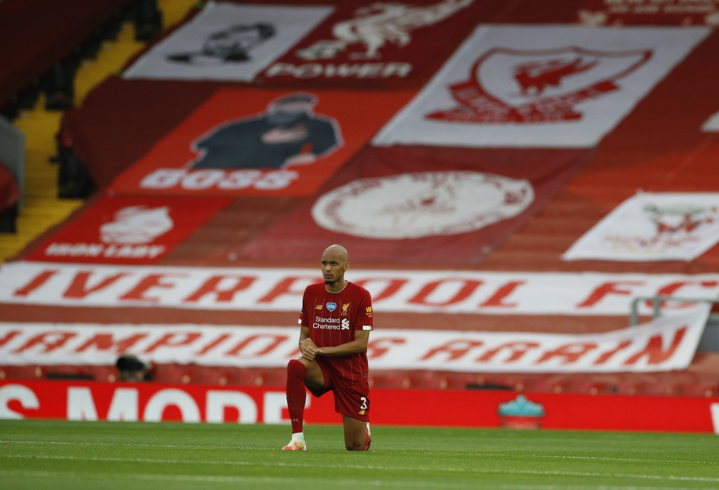 Liverpool's Fabinho takes a knee just prior to the start of the English Premier League soccer match between Liverpool and Chelsea at Anfield Stadium i...