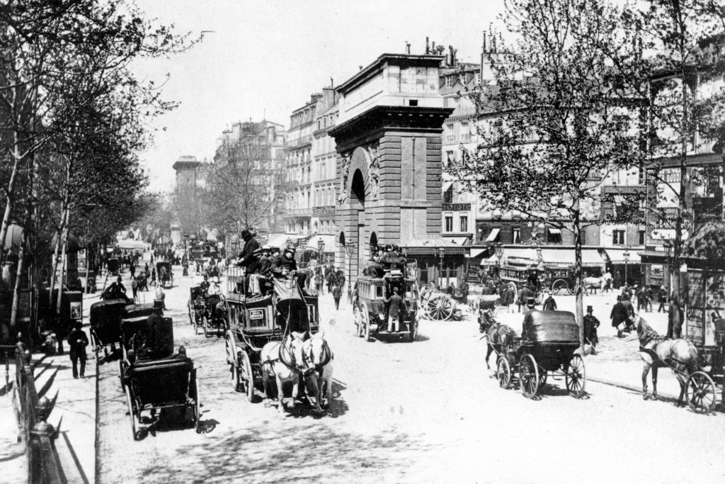 FILE - This 1900 file photo shows the eastern part of a busy boulevard in Paris, France in the year 1900. No opening ceremony. No closing ceremony. An...