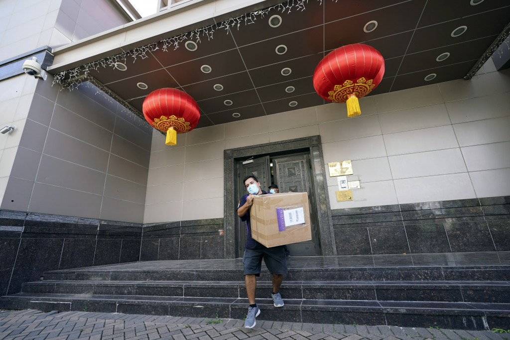FedEx employee removes box from China's consulate in Houston on July 23, 2020.