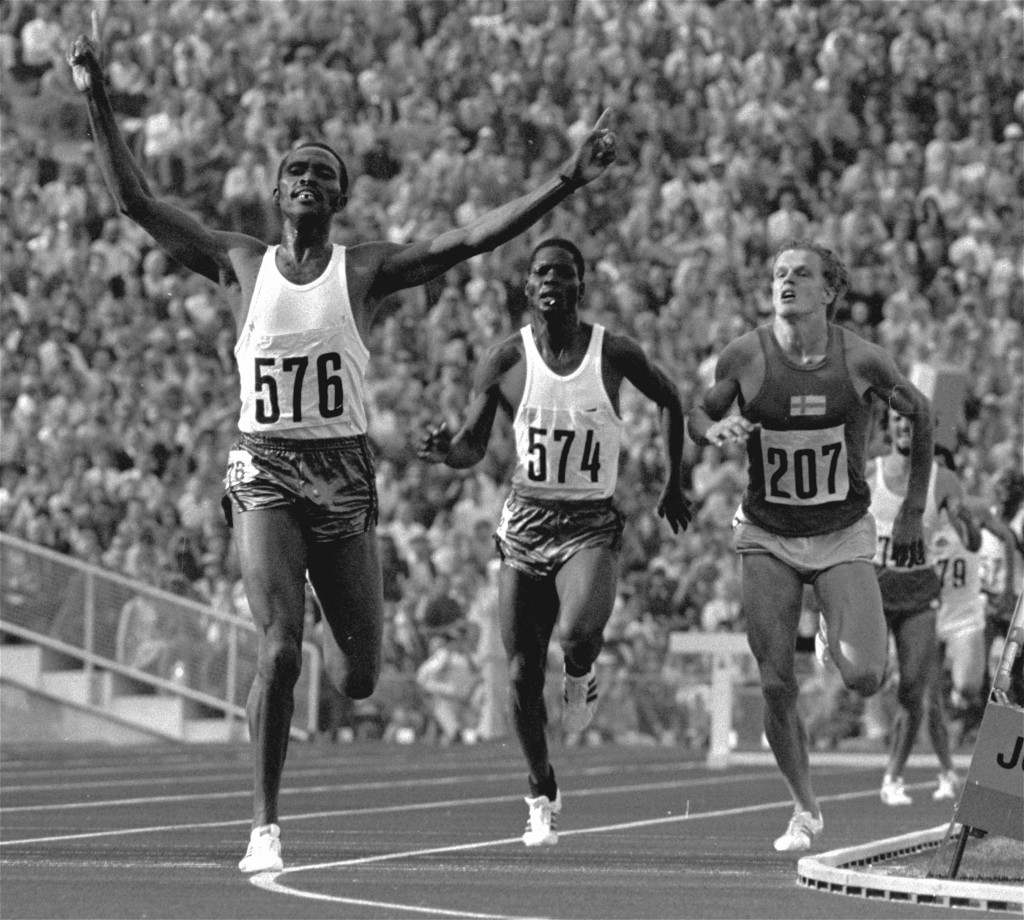 FILE - In this Sept. 4, 1972 file photo, Kipchoge Keino of Kenya raises his arms in triumph as he wins the final of the Olympic games 3,000-meter stee...