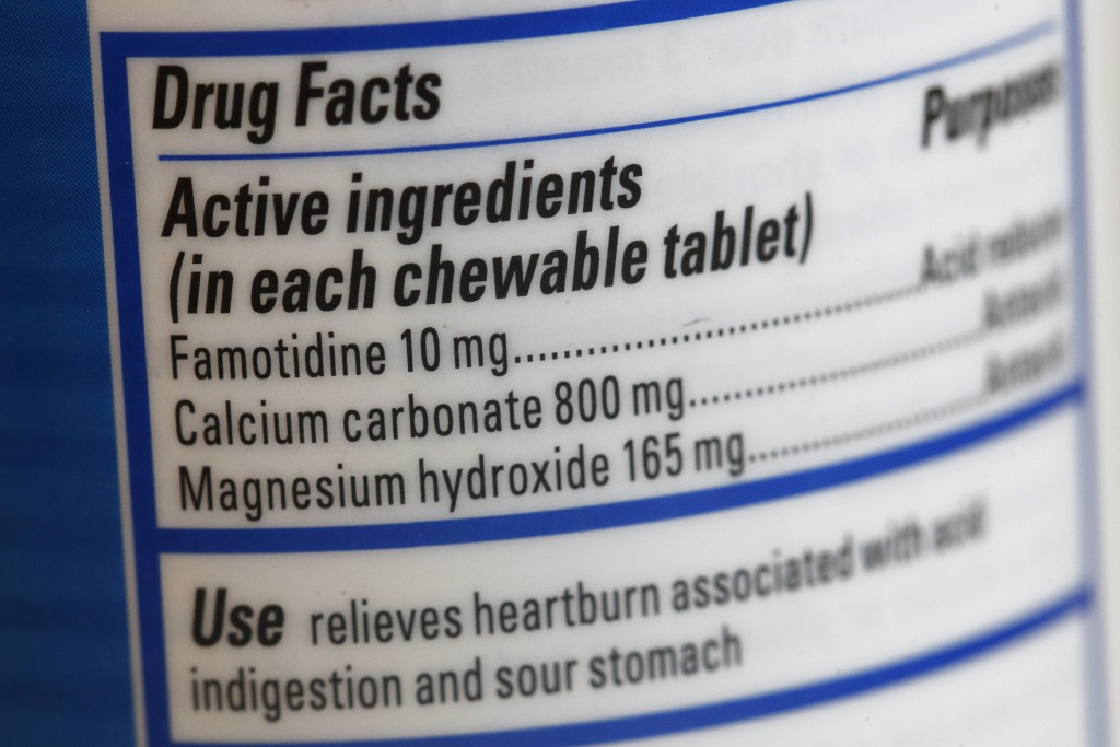 This June 15, 2020 photo shows a Pepcid antacid label listing the active ingredient famotidine in Washington. The U.S. government's Pepcid project has...
