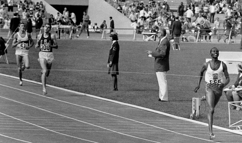 FILE - In this Oct. 20, 1968 file photo, Kipchoge Keino of Kenya hits finish line of 1968 Olympics 1500 meter run Oct. 20, 1968 in 3 minutes, 34.9 sec...
