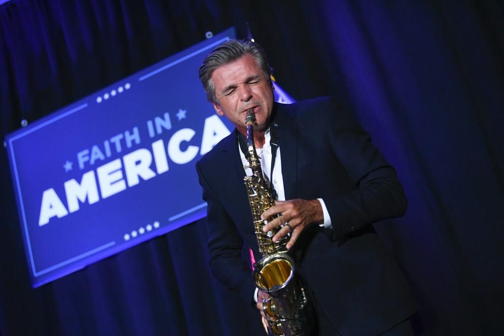 Pastor Jentezen Franklin plays the saxophone during a President Donald Trump campaign event courting devout conservatives by combining praise, prayer ...