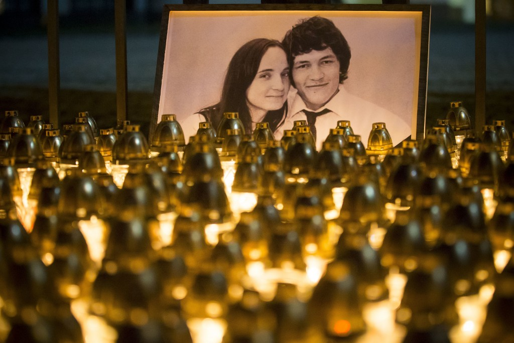 FILE - In this Wednesday, Feb. 28, 2018 file photo, light tributes are seen during a silent protest in memory of murdered journalist Jan Kuciak and hi...