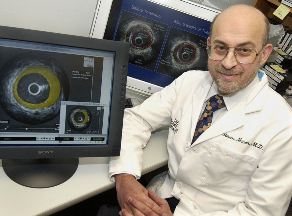 FILE - In this  Jan. 16, 2004 file photo, Dr. Steven Nissen poses for a photo in his laboratory at the Cleveland Clinic beside screens with ultrasound...